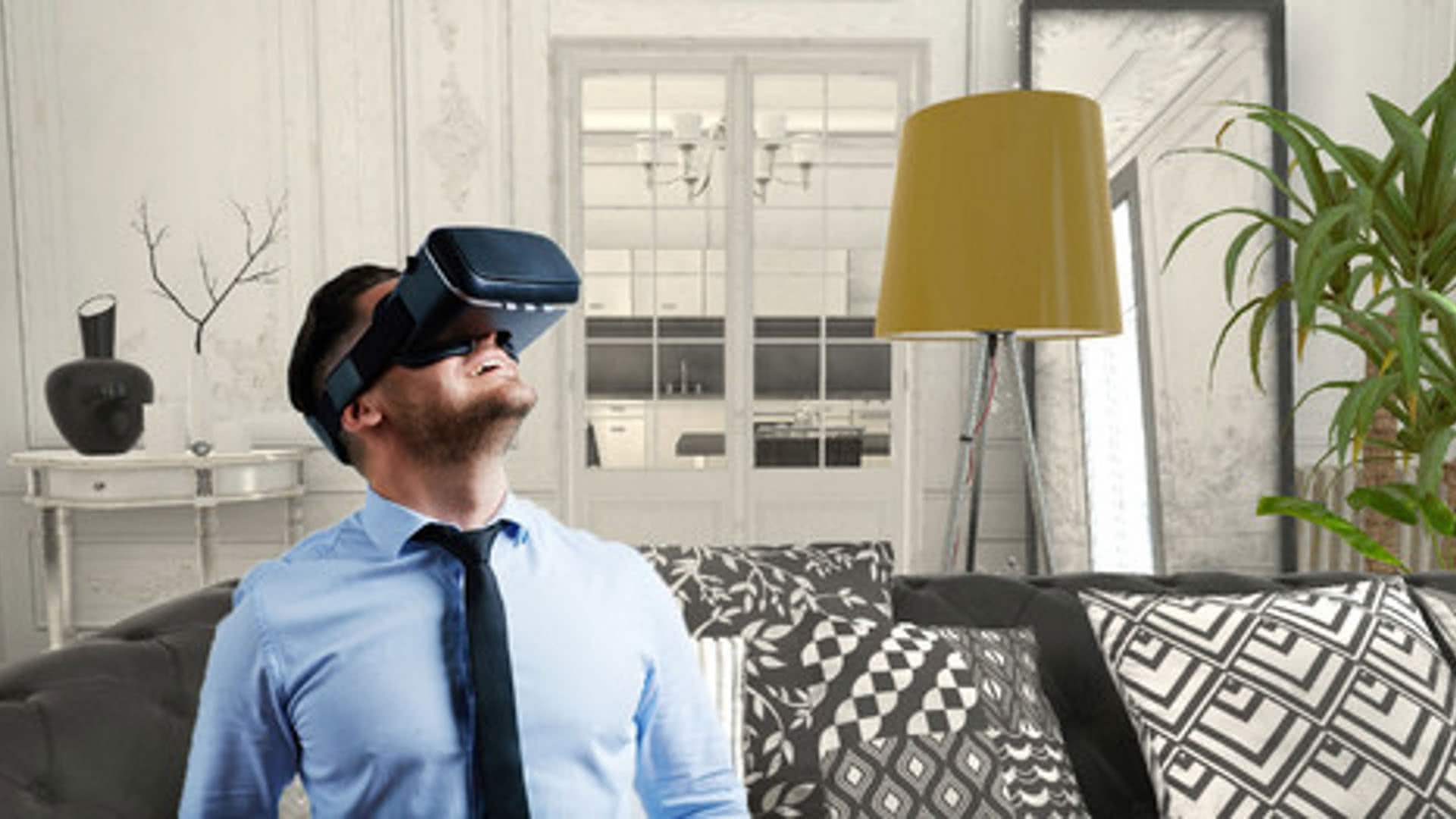 Man watching Virtual reality appartment in googles