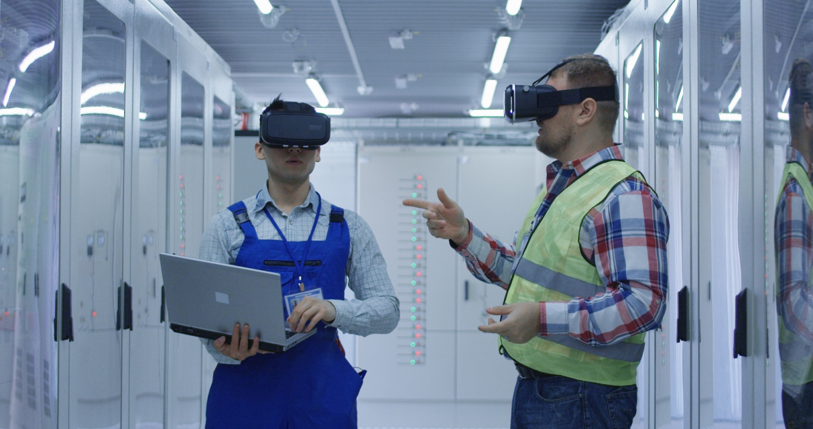 Men working in VR headset on plant