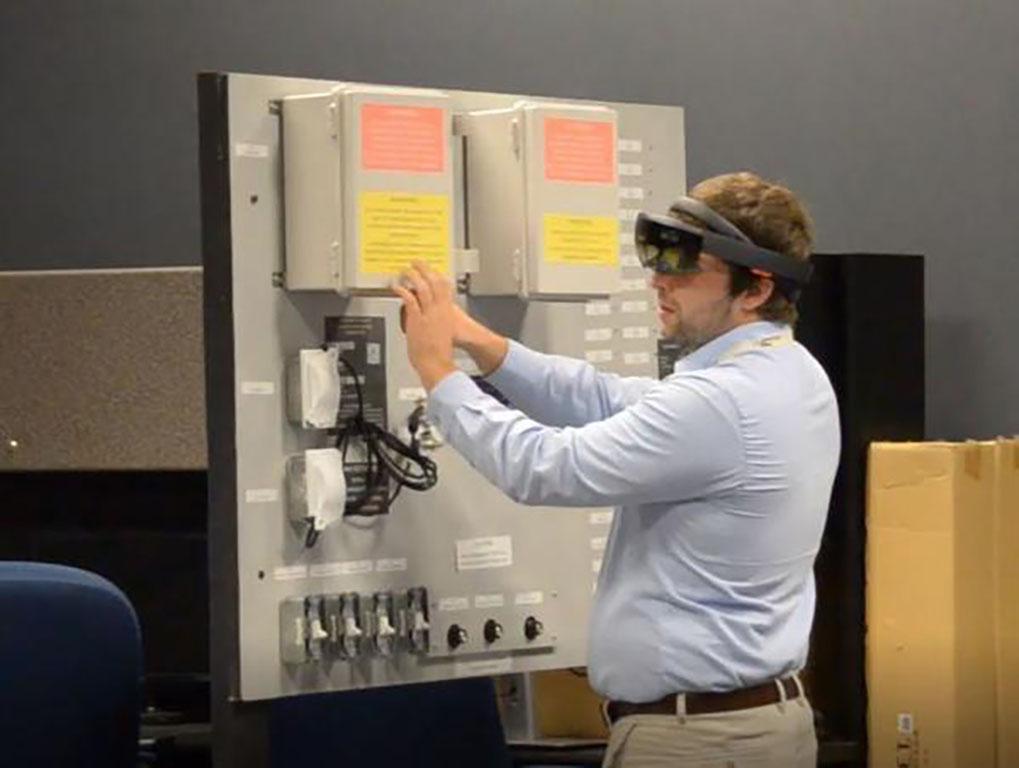 Man in augmented reality headset training
